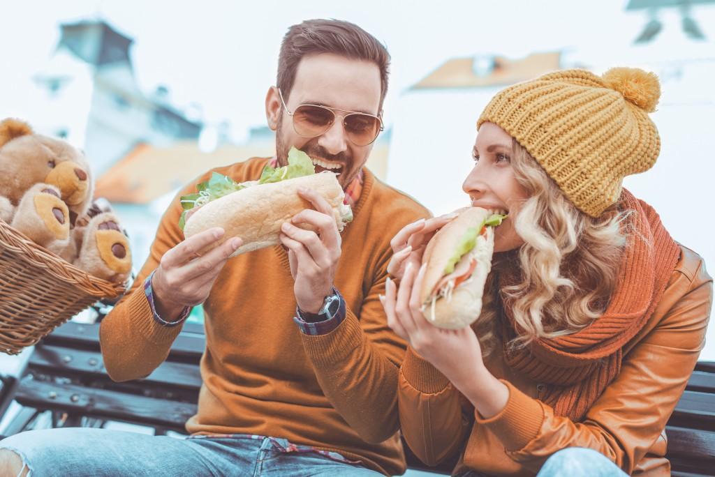 Friends enjoying big sandwiches