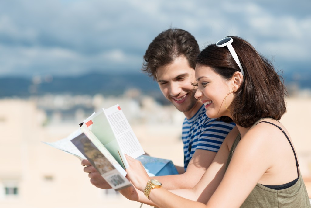 couple consulting their travel guide