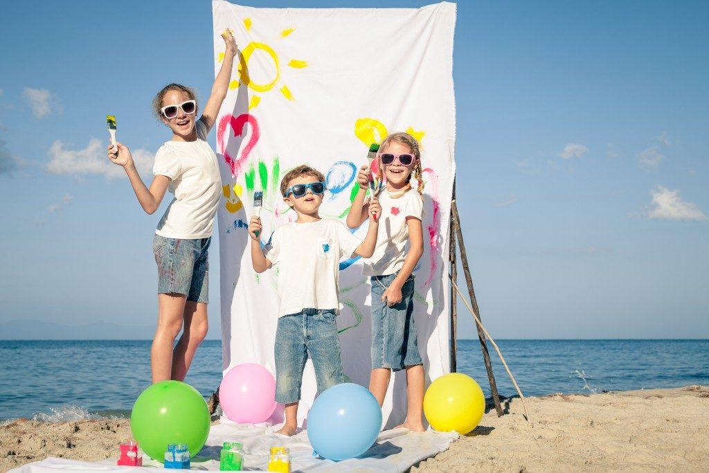 Three children playing on the beach