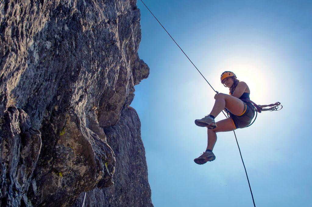 Woman mountain climbing