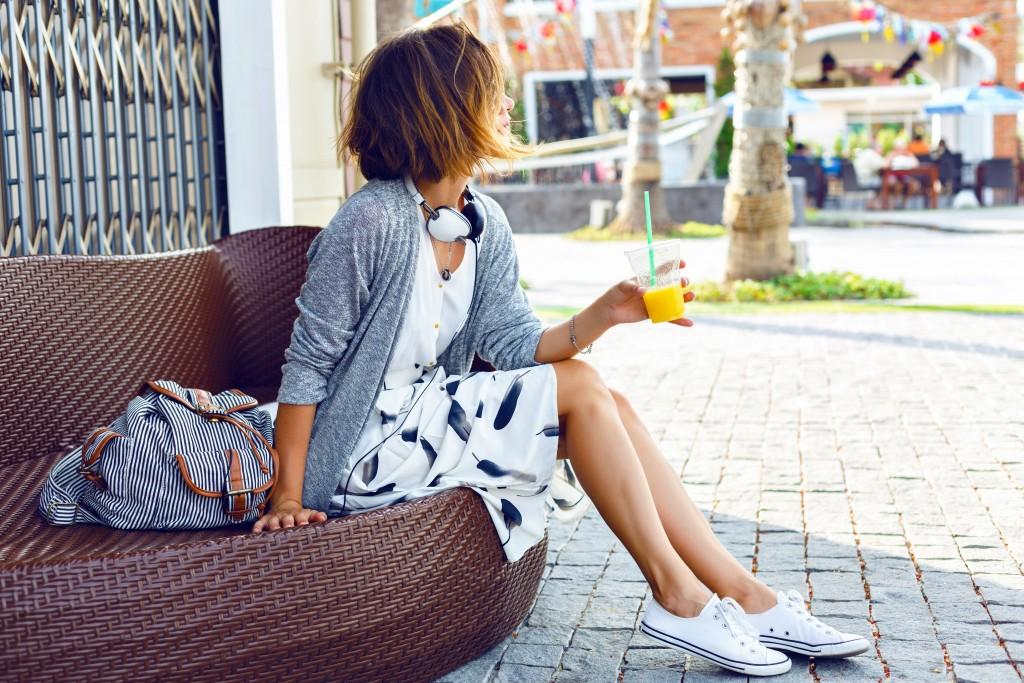 a woman wearing white shoes
